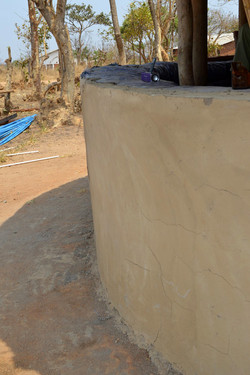 Malawi Sam's village half wall constructed with rammed earth (submitted by The L