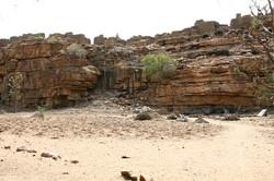 Mali Niongono village  Niongono, sitting on its rock, viewed from the surroundin