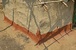 Decorative band at a base of a home. The mud came from a near by river bed in Lufani village Malawi, malawi architecture