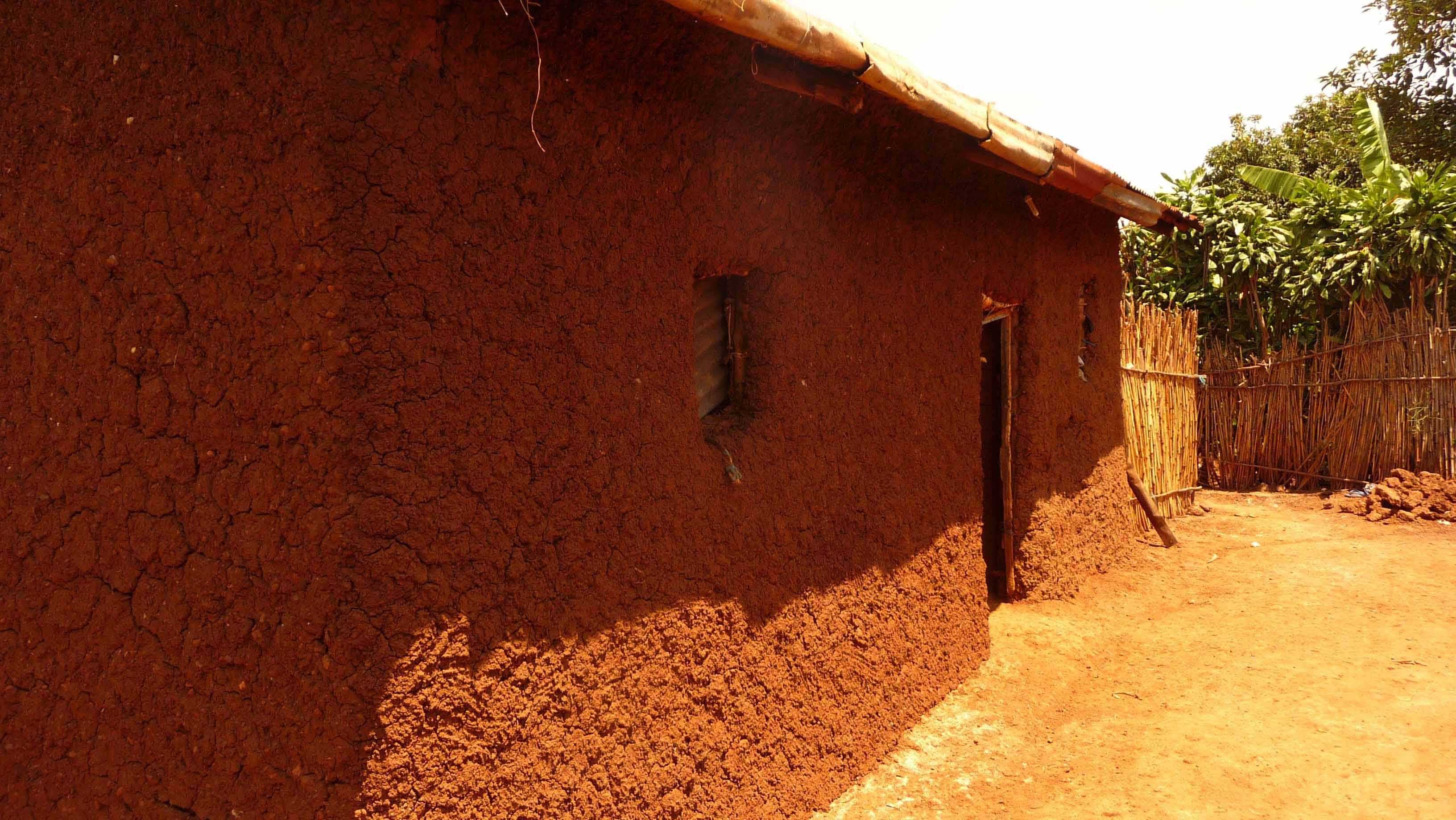 Rwanda recently re-plastered wall - exposure and unfinsished quality of the plas