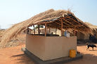 An outdoor kitchen that is rectangular and has walls rising 1 meter high inNkhombe village Malawi, malawi architecture