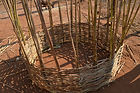 The basket for a grainery is being weaved with reeds in M'buka village Malawi, malawi architecture