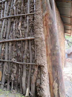 Ethiopia home constructed with mud applied on a wood frame close up (submitted b