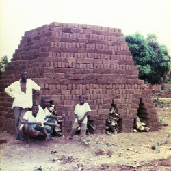 Zambia bricks are stacked to create a kiln which is then burned.jpg