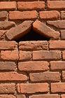 Small triangular window formed with burnt bricks in Pasani village Malawi, malawi architecture