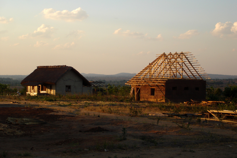 Malawi Sam's village roof structure being constructed on rammed earth walls (sub