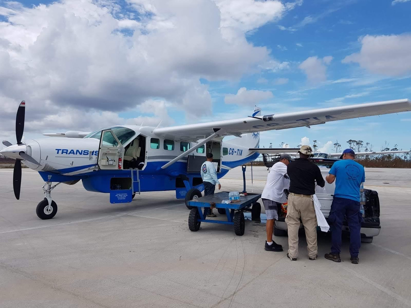 Trans Island Airways loading up their plane with relief items