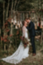Bride and Groom kissing - Gabriela Gown - by Rish
