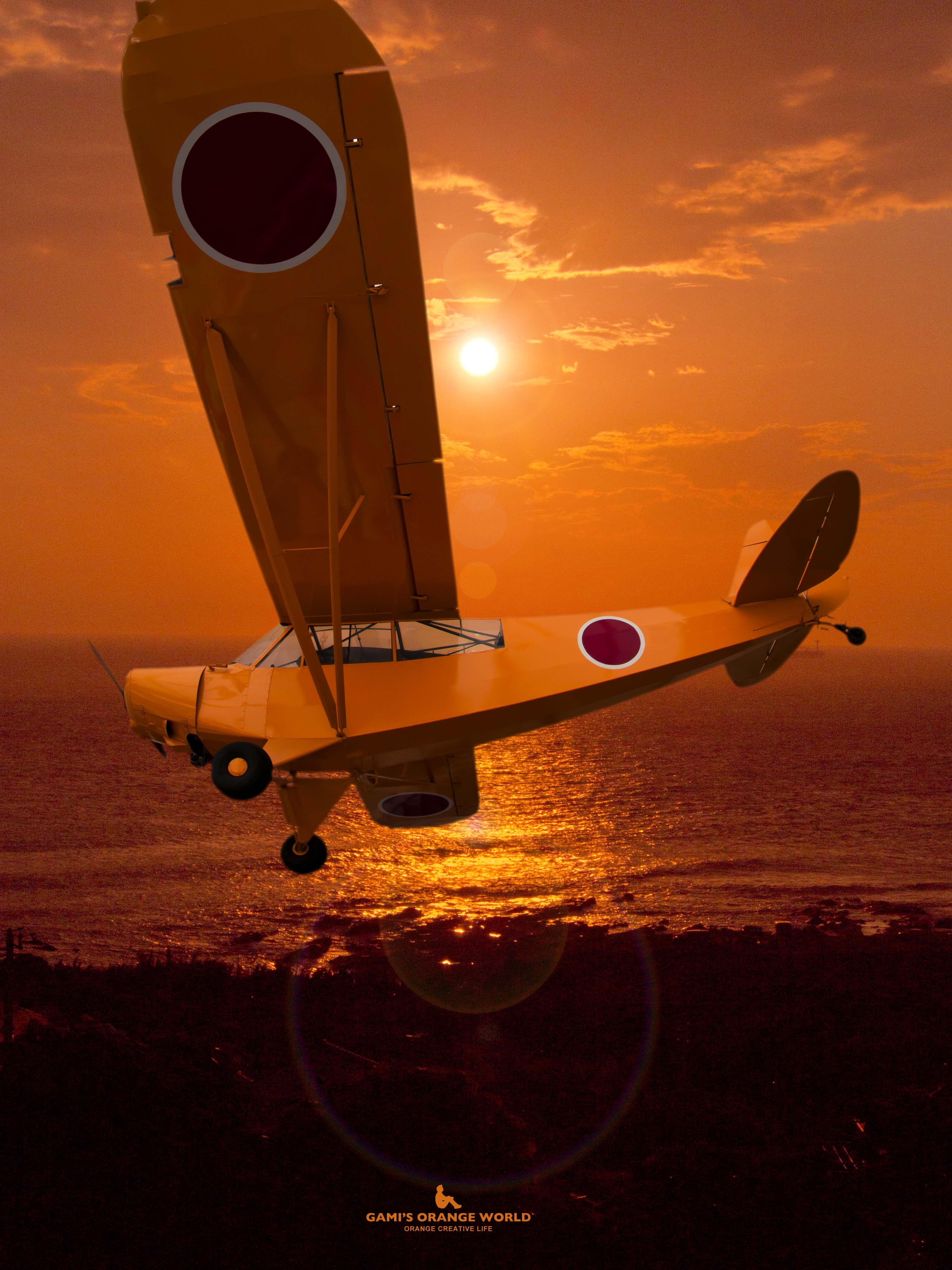 オレンジの空を飛ぶオレンジセスナ