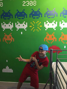 HB Murals by Hannah Baker at Snugglebunch. Cool Space Invaders Children's Bedroom Mural