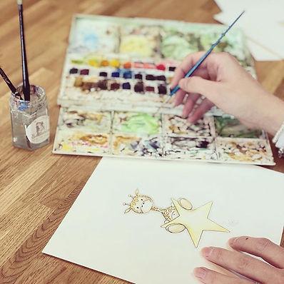 Artist Hannah Baker of Snugglebunch creating a watercolour art print for a children's bedroom