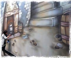Hannah Baker painting a Cinderella Kitchen Theatre Cloth