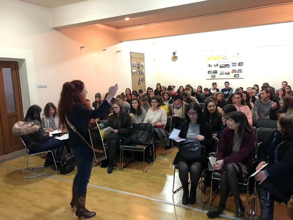 Arts Envoy IPR Romania 2018 visiting with high school students in Sibiu Amanda Colleen Williams pilot