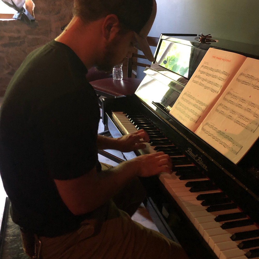 Long time student Taylor Lewis works on his piano chops at Songpreneurs HQ in Nashville, Tennessee.