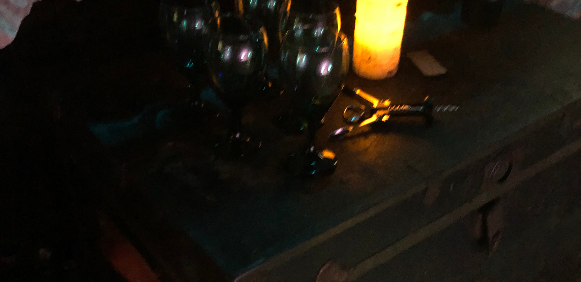 Candles and wine near the fireplace