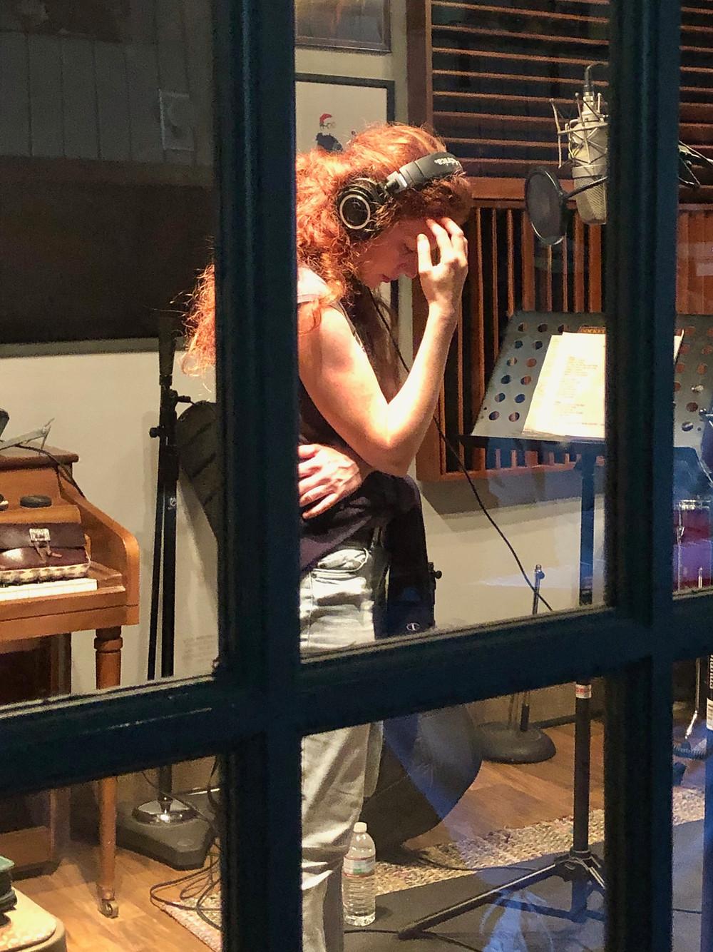Amanda Colleen Williams Nashville red headed singer songwriter in the recording studio headphones tracking new album