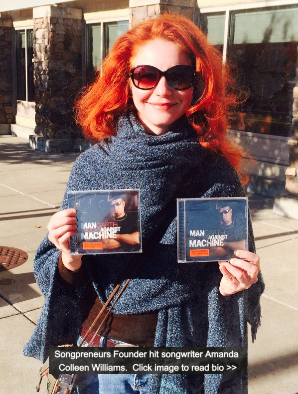 Red headed Nashville hit songwriter Amanda Colleen Williams holding two Garth Brooks albums Man Against Machine.