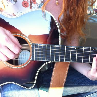 Amanda Colleen Williams playing guitar Breedlove