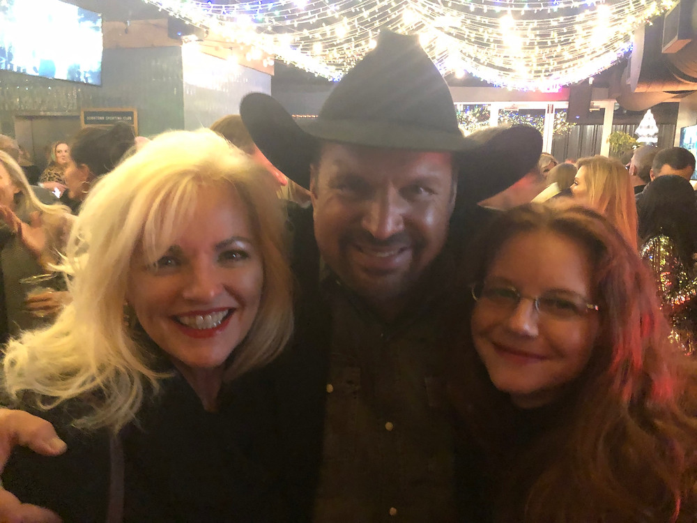 Songwriters Benita Hill and Amanda Colleen Williams congratulate Garth Brooks on his CMA Entertainer of the Year 2019 Award