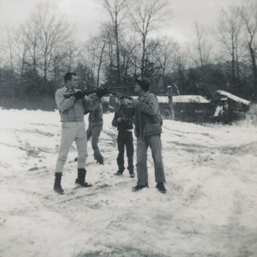 This is Uncle Larry (L) and a neighbor Melvin Johnson facing off with guns with Dad Kim Williams (L) and Uncle Herschel watching from behind in a show of hillbilly bravado