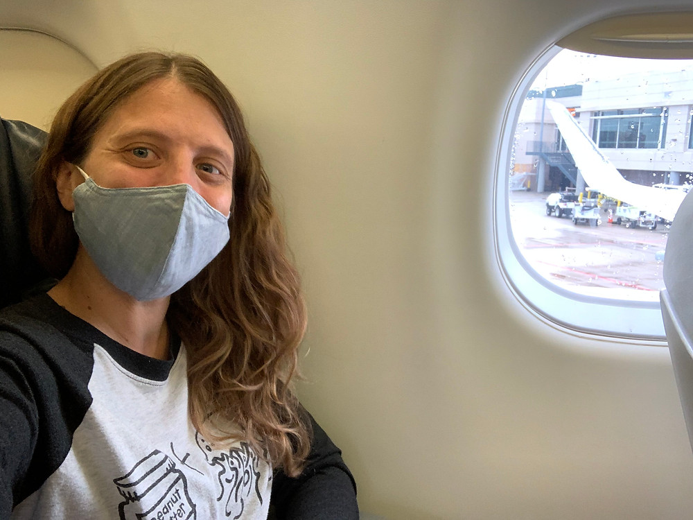 Wearing a mask on an airplane during COVID