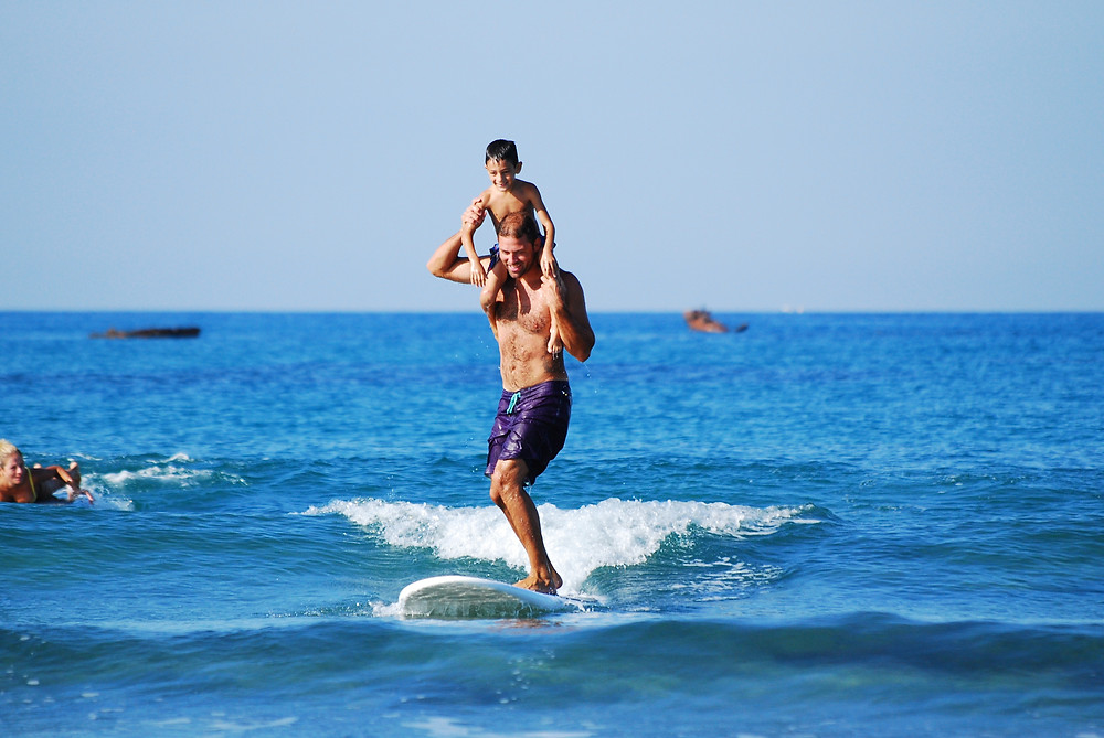 Dad and son surfing