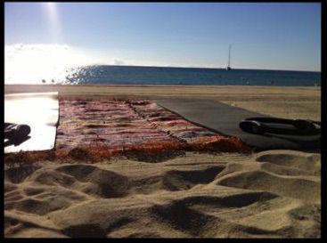 Cours de pilates/fitness sur la plage