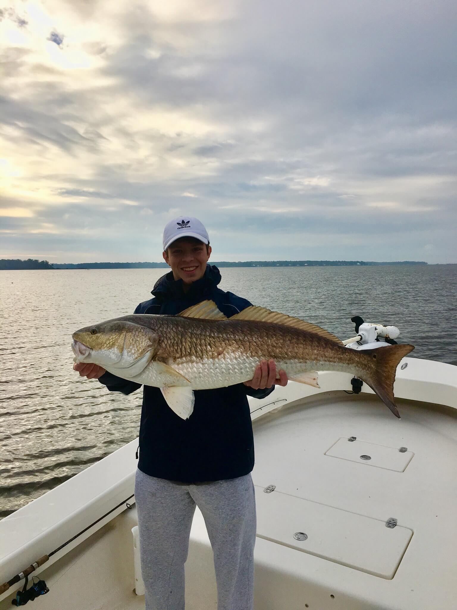 kids fishing with bull red