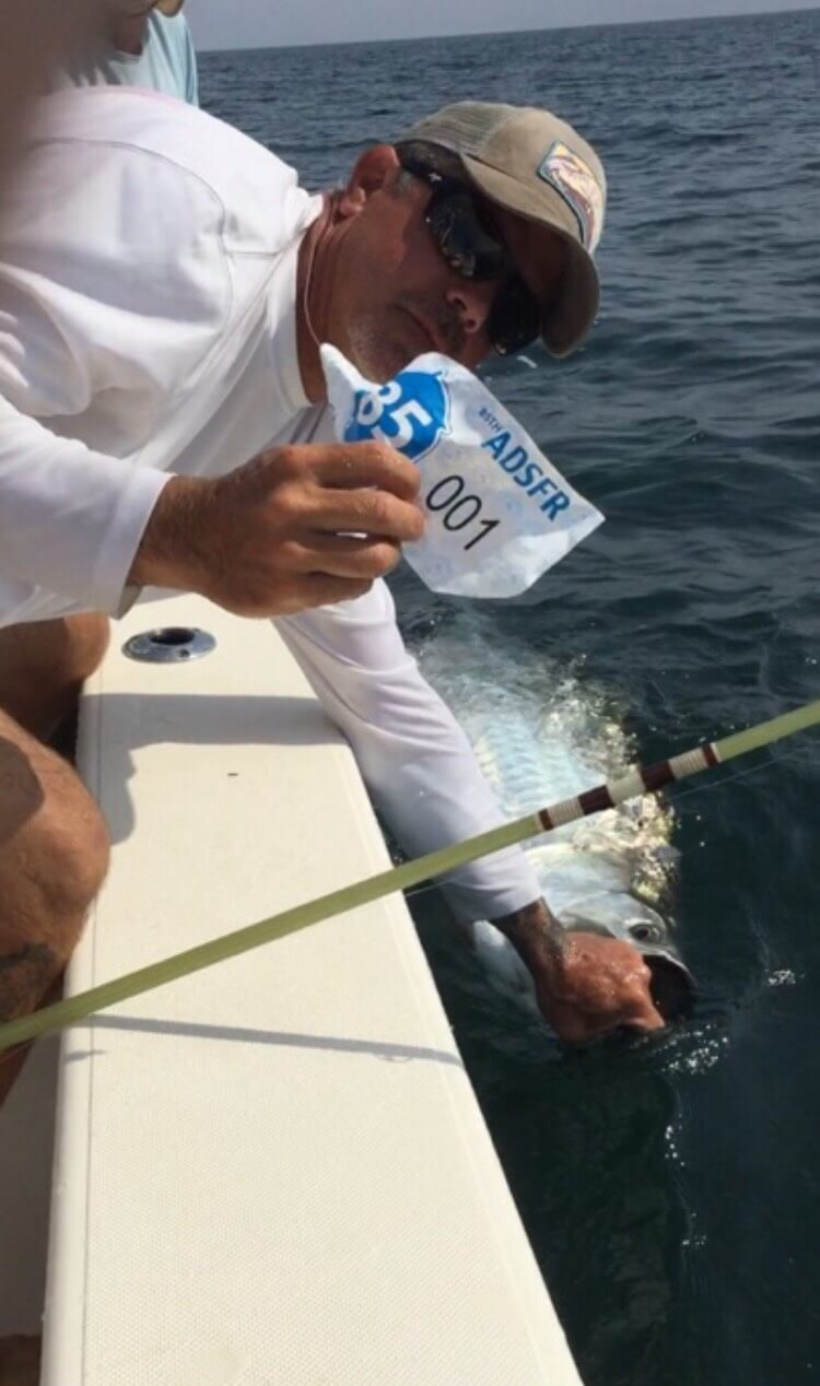 chris with 001 tarpon tag