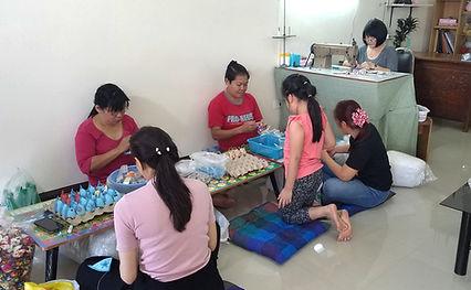 group of women making cat toys..jpg
