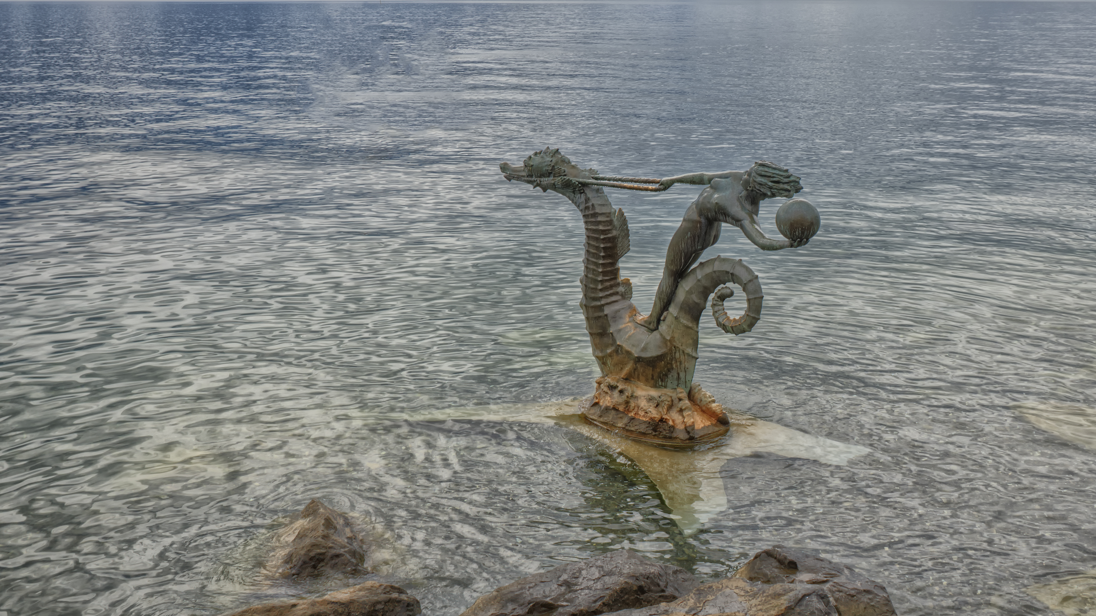 Statue of a woman riding a seahorse