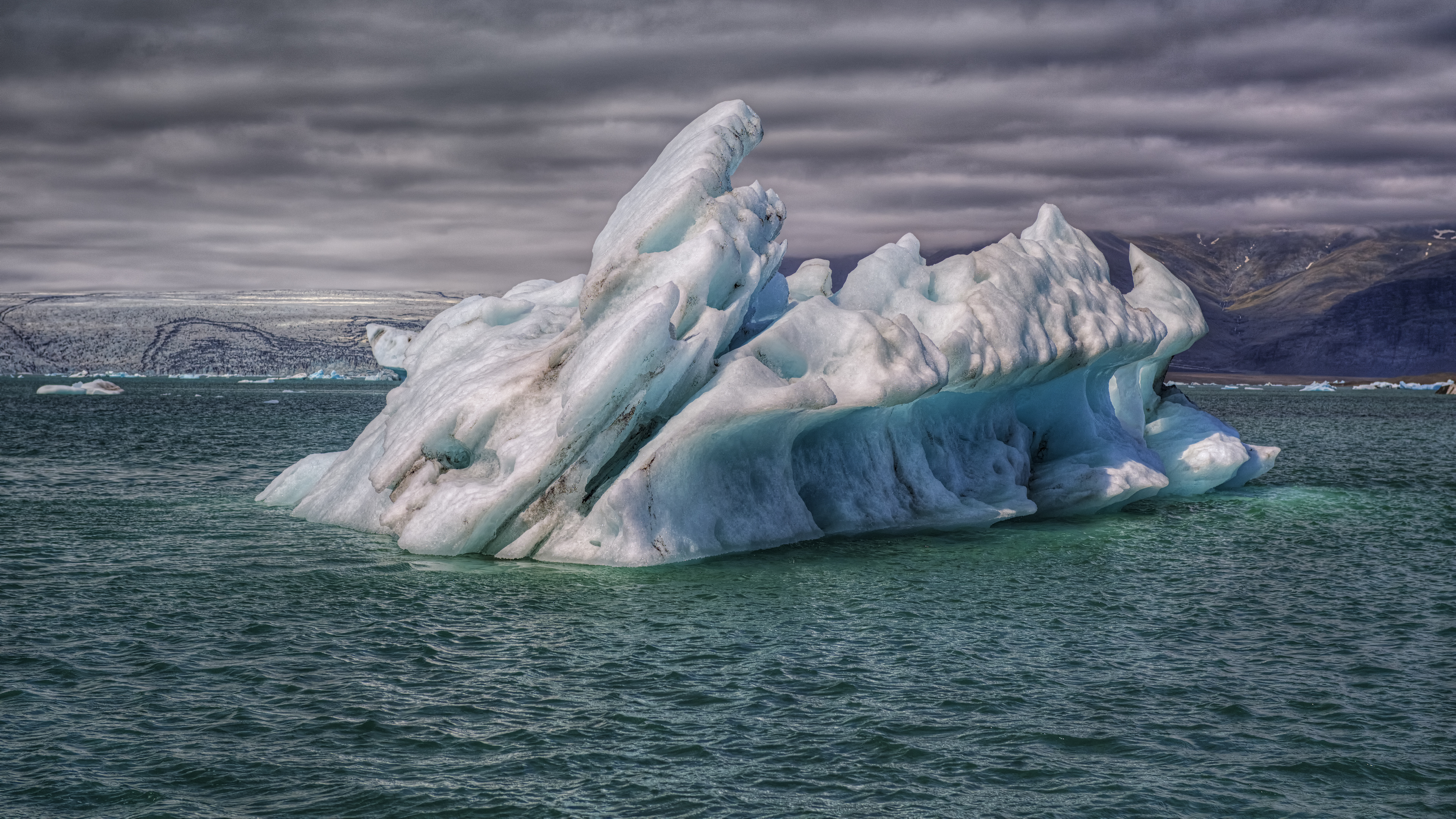 Iceberg with Glacier in background