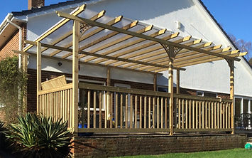 Wooden Garden Decorative Pergola with wooden hand rails and balustrading Cheap, value for money, quality, experienced, professional. Dorset, Bournemouth, Christchurch, Poole, Ferndown, Wimborne, Ringwood, Boscombe, Parkstone, Southborne, Winton, Charminster, Corse Mullen, Broadstone, Westborne, Bearwood, Verwood, Canford Heath, Upton, Wareham, Lymington, New Milton, Lynhurst, Brockenhurst, Burley, New Forest, Fordingbridge