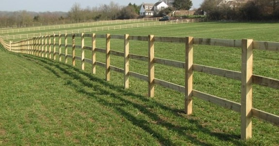 Post and rail paddock fence