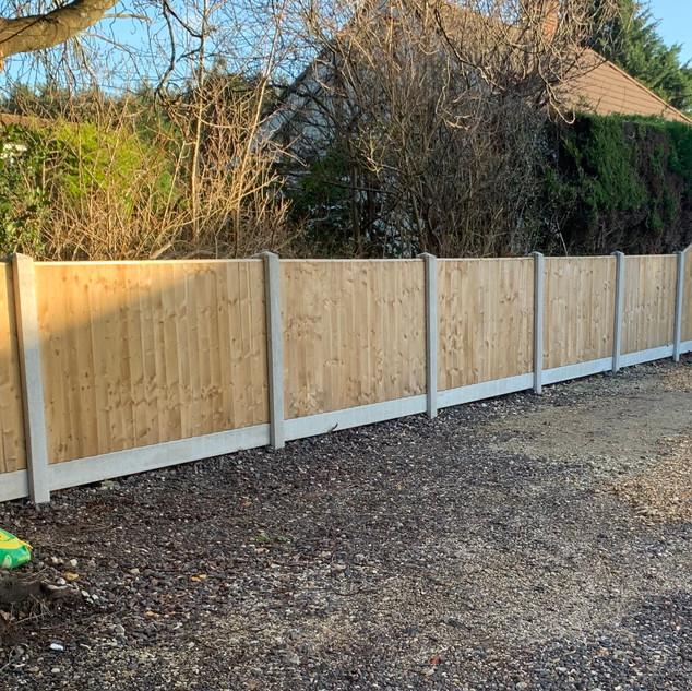 Closeboard panel split level fence