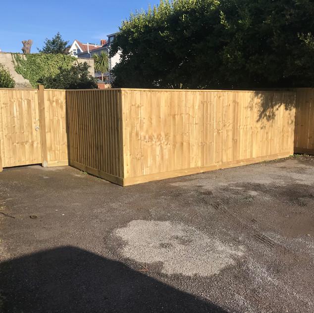 Closeboard fence and pedestrian gate