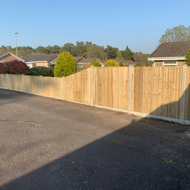Wooden Panel Fencing with Concrete Posts and Gravelboards