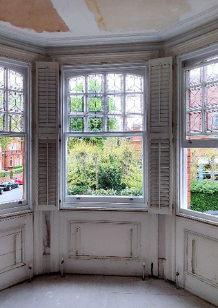 Restoration. Sash windows with the stain