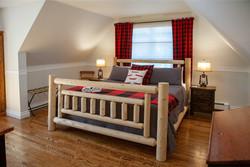 Cedar log bed - Bruce Peninsula suite