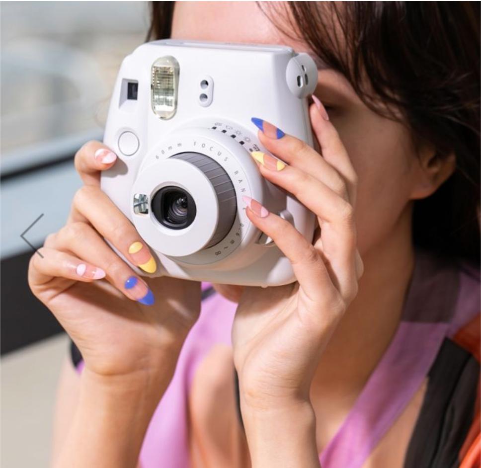 Press on nails - Rebecca Minkoff - imPress Manicure Kit - Girl holding a camera