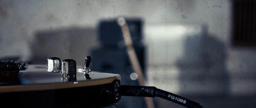 Frame Grab Guitar CU cropped.jpg