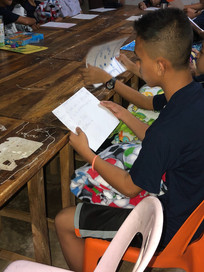 boys reading the letters from our kids