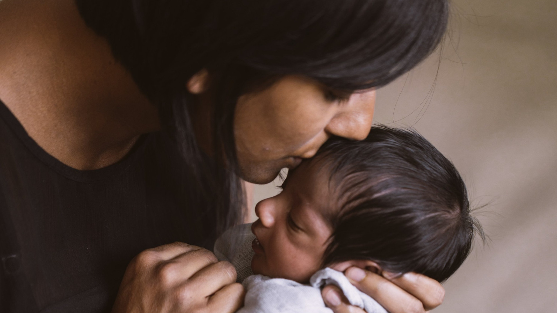 mother-kissing-newborn%20-%20Copy_edited