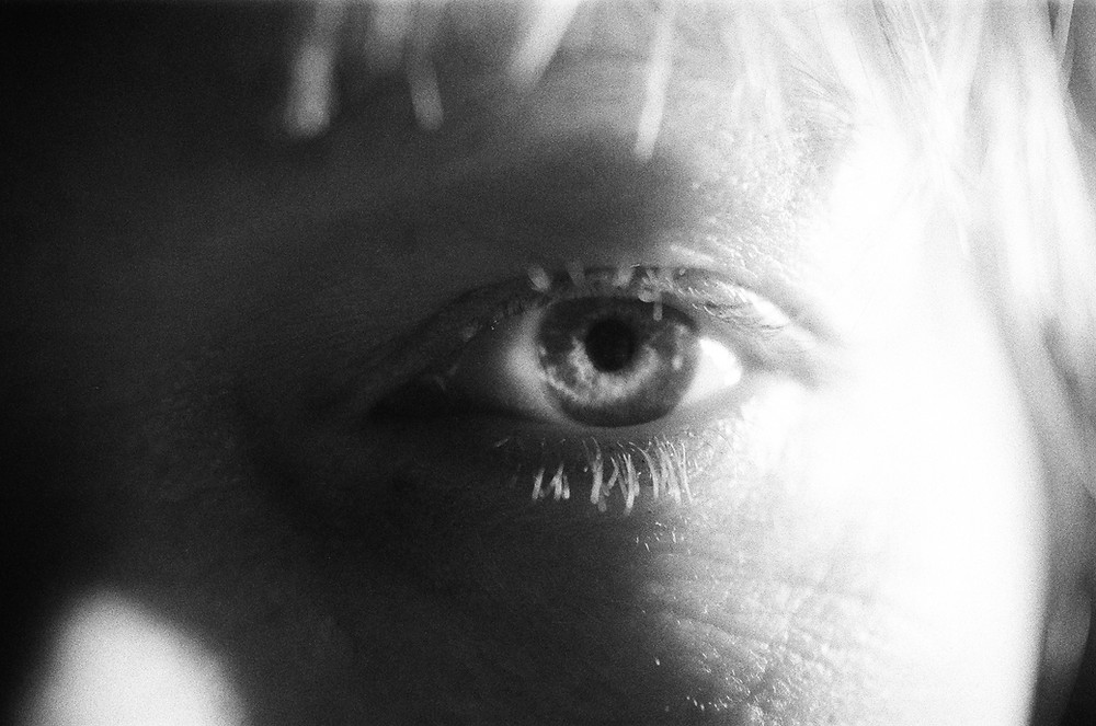 a black and white photo of a woman's eye from Lina Scheynius photo-essay for Tabayer Jewelry