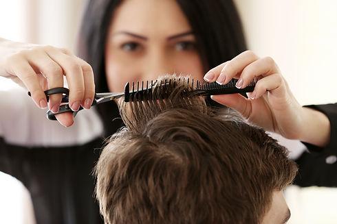 Professional hairdresser making stylish
