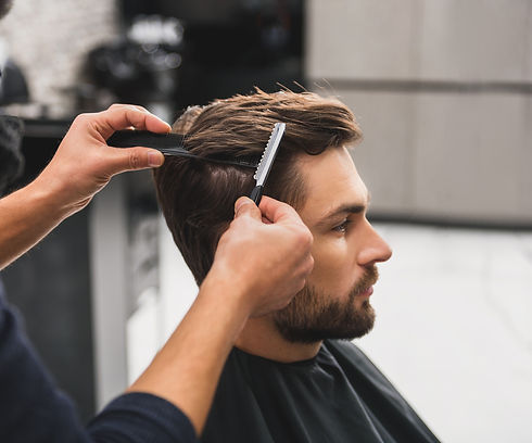 Male%20client%20getting%20haircut%20by%2