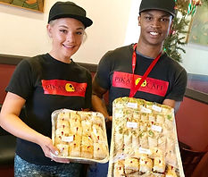 Pika's Cafe team members with Sandwich Platters
