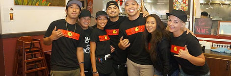 Pika's Cafe Team Photo with Local Musician Joe Guam