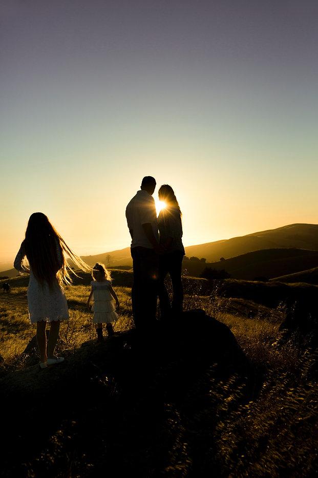 Family Overlooking Hills