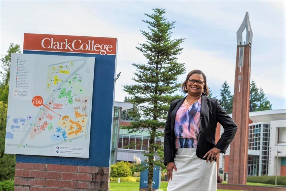 Karin Edwards is standing next to the Clark College directory